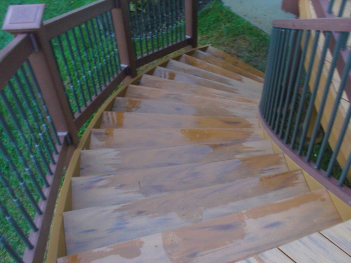 curved timbertech  deck stairs